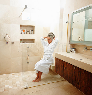 Buy stock photo Beautiful mature woman in bathrobe in a modern bathroom