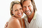 Closeup portrait of a sweet loving couple smiling together