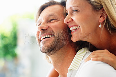 Buy stock photo Closeup portrait of a happy mature couple looking at something interesting