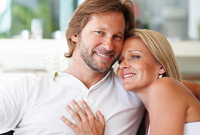 Buy stock photo Closeup portrait of a loving relaxed mature man and woman smiling