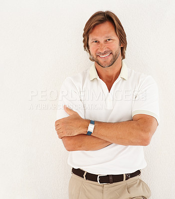 Buy stock photo Portrait of a smart casual man smiling with hands folded against white background