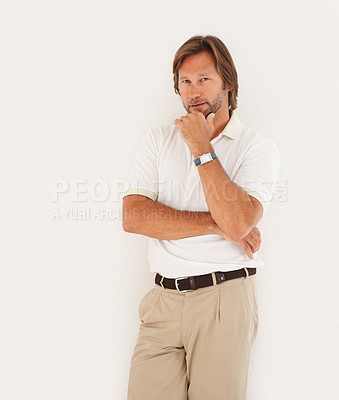 Buy stock photo Portrait of a smart confident casual man standing isolated against white background