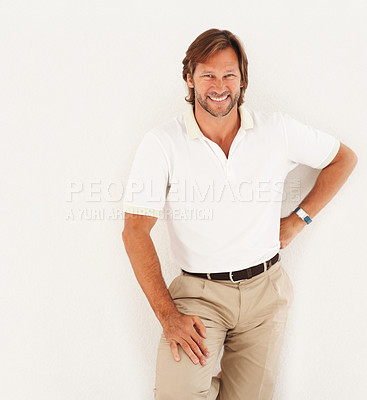 Buy stock photo Portrait of a happy friendly mature man smiling isolated against white background