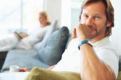 Buy stock photo Closeup portrait of a smart mature man with woman reading book in the background