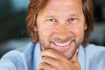Buy stock photo Detail shot of a happy middle aged man with hand on chin giving you a smile
