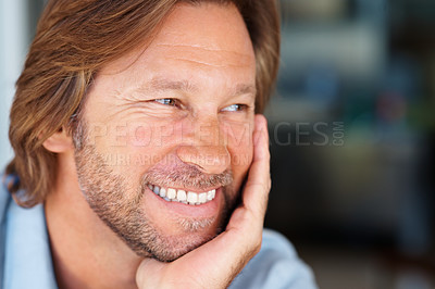 Buy stock photo Closeup portrait of a happy mature man smiling over a happy thought
