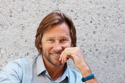 Buy stock photo Closeup portrait of a happy mature man smiling against wall