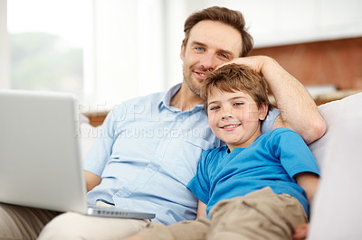 Buy stock photo Portrait of a smiling young father and son relaxing on sofa with a laptop - Indoor