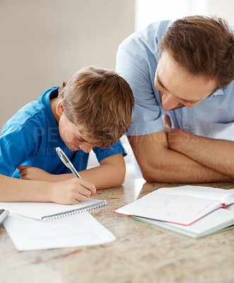 Buy stock photo Portrait of a young father helping his son with his homework - Indoor