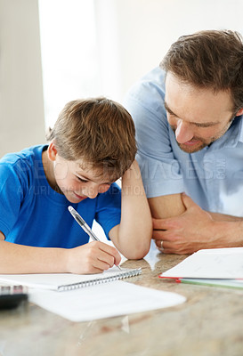 Buy stock photo Portrait of a cute little boy doing homework with his father - Indoor