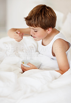 Buy stock photo Portrait of a small boy having healthy breakfast on bed