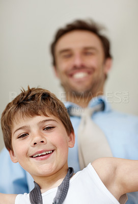 Buy stock photo Portrait of a adorable small kid smiling with his father