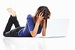 Frustrated girl in angry mood with laptop lying on white surface