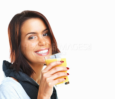 Buy stock photo Sportive girl drinking orange juice on white background - copyspace