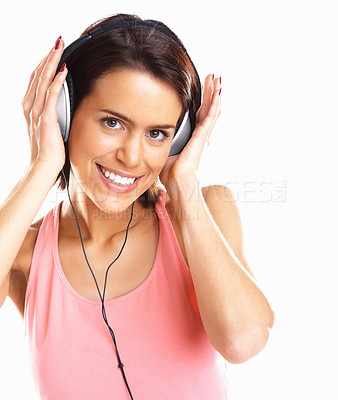Buy stock photo Beautiful young woman enjoying music through headphones against white background