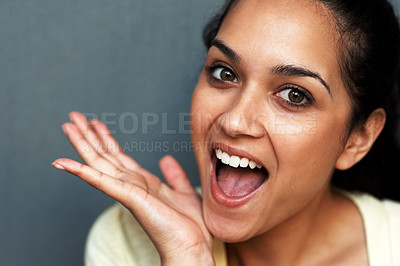 Buy stock photo Closeup portrait of an excited young woman screaming against grey background
