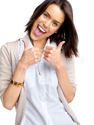 Buy stock photo Portrait of an excited young woman gesturing a thumbs up sign against white background