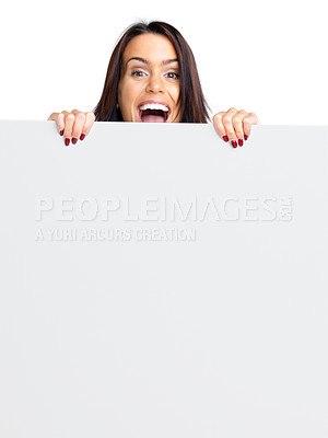 Buy stock photo Portrait of a happy young female holding a blank bill board against white background