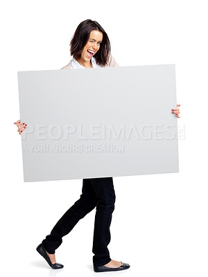 Buy stock photo Full length portrait of a happy young woman showing a blank board over white isolated  background