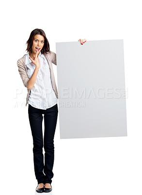 Buy stock photo Full length portrait of a beautiful young woman holding a empty bill board over white background