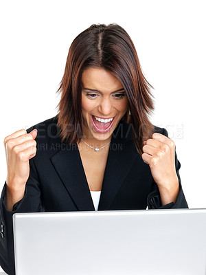 Buy stock photo Portrait of an excited young businesswoman while working on laptop against white background