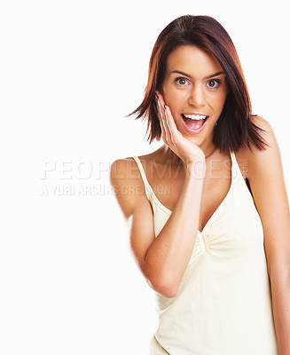 Buy stock photo Surprised and happy young woman with hand on chin isolated against white background