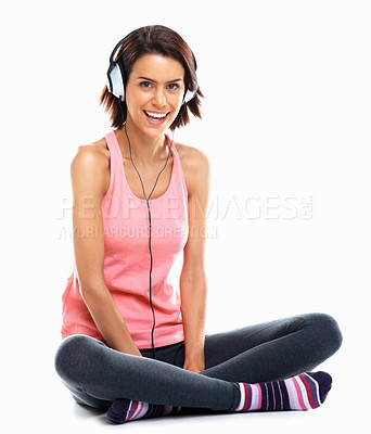 Buy stock photo Relaxed happy young woman enjoying music against white background