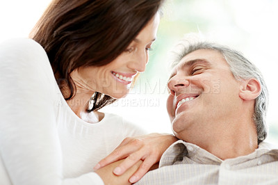 Buy stock photo Portrait of a happy mature couple looking at each other and smiling