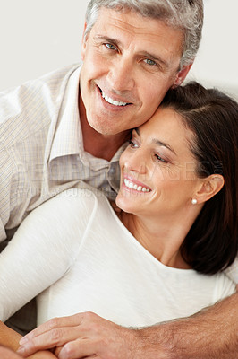 Buy stock photo Happy middle aged man and his beautiful wife looking away