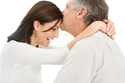 Buy stock photo Happy middle aged man kissing his beautiful wife on forehead