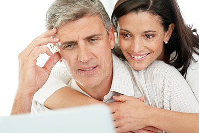 Buy stock photo Portrait of a mature couple using internet on laptop computer