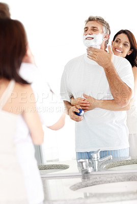 Buy stock photo Portrait of mature man shaving his wife holding her husband from behind