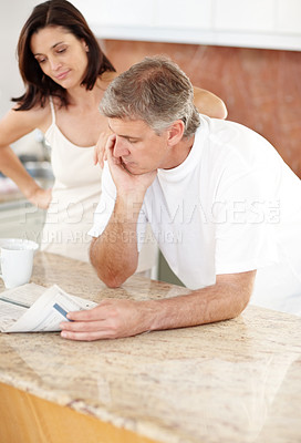 Buy stock photo Portrait of mature couple in kitchen with newspaper and coffee