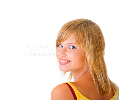 Buy stock photo Looking over her shoulder - Portrait of a beautiful Isolated young female student, taken in our studio.