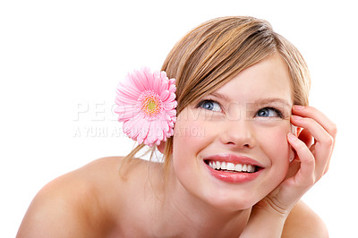 Buy stock photo Cute teenager looking at copyspace in the corner of her eye.