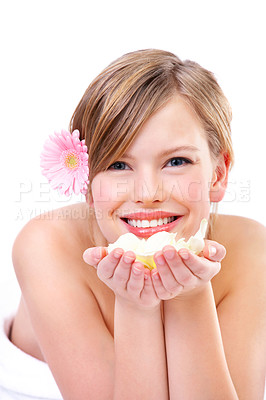 Buy stock photo Young woman holding rose petals, smiling, portrait.