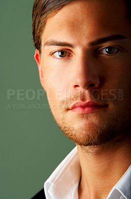 Buy stock photo Portrait of a happy young business man isolated on green