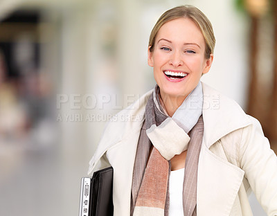 Buy stock photo Close-up portrait of young beautiful business woman carrying laptop
