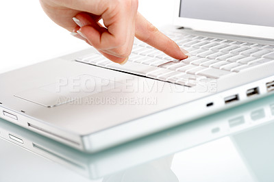 Buy stock photo One press of a finger...Modern laptop isolated on white with reflections on glass table.