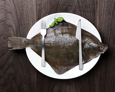 Buy stock photo Slightly humorous dish. Raw fish on a plate.