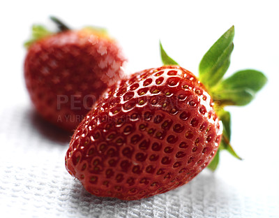Buy stock photo Detailed close-up of two strawberries on white