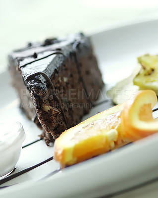 Buy stock photo A wonderful chocolate cake with oranges on the side.