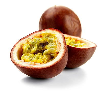 Buy stock photo Shot of an isolated passionfruit, cut open.