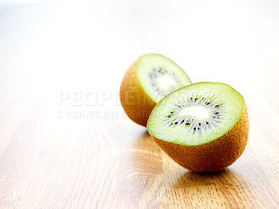 Buy stock photo Macro shot of a kiwi cut in half