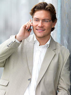 Buy stock photo Smiling businessman using mobile phone