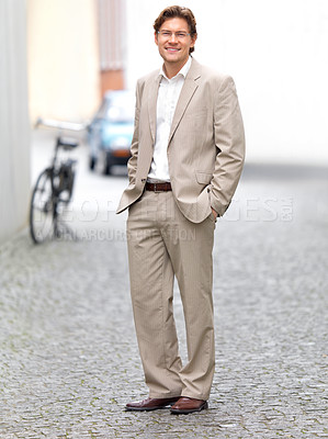 Buy stock photo Portrait of a businessman standing with hands in pockets