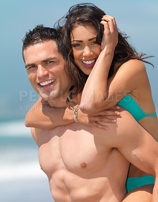 Buy stock photo Portrait of a smiling beautiful young couple in love. Man giving woman a piggyback.