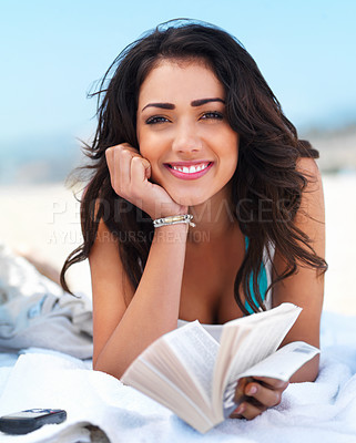 Buy stock photo Portrait of a happy young woman holding book