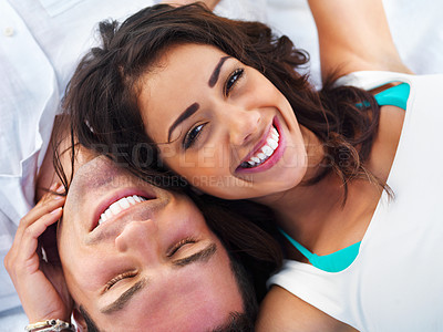 Buy stock photo Close up portrait of a smiling young couple relaxing