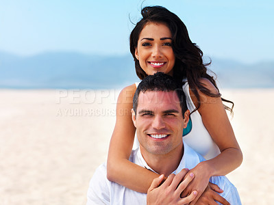 Buy stock photo Portrait of a smiling young couple on beach